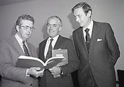 Liam Kavanagh being presented with Building Regulations Manual, <br />