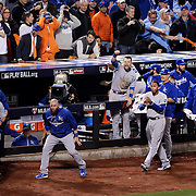 Eric Hosmer, (bottom left), Kansas City Royals, is congratulated by team mates after leveling the scores in the ninth inning during the New York Mets Vs Kansas City Royals, Game 5 of the MLB World Series at Citi Field, Queens, New York. USA. 1st November 2015. Photo Tim Clayton