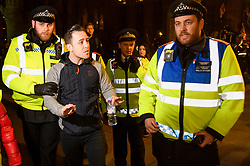 "© Licensed to London News Pictures. 15/01/2019. London, UK. An anti EU campaigner DANNY ""TOMMO"" is arrested by police outside Parliament in Westminster, London, on the day that MP's will vote on British Prime Minster Theresa May's proposed transition deal with the EU on the UK's exit from the European Union. Photo credit: Ben Cawthra/LNP"