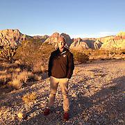 November 9, 2014, Las Vegas, Nevada:<br /> Billie Weiss poses as the sun rises over Red Rocks park in Las Vegas, Nevada Sunday, November 9, 2014.<br /> (Photo by Billie Weiss/TEAMS)