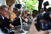 Gigi Hadid, fashion model, leave the Fendi fashion show during the annual Milan Fashion Week, Milan September 22, 2016.