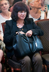 © Licensed to London News Pictures. 26/05/2017. London, UK. Laura Alvarez, wife of Labour party leader Jeremy Corbyn, waits to hear his election campaign speech in Westminster. All election campaigning was stopped as a mark of respect for the victims of Monday's terror attack in Manchester in which 22 people died. Photo credit: Peter Macdiarmid/LNP