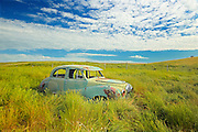 Old Austin car in field in ghost town <br /> Neidpath<br /> Saskatchewan<br /> Canada