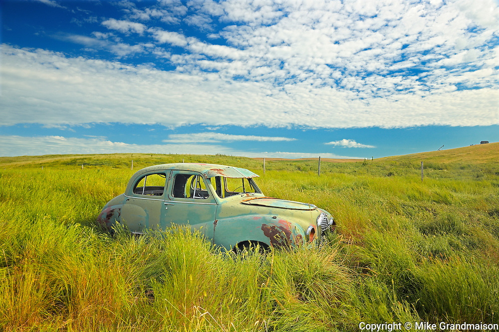 Old Austin car in field in ghost town <br /> Neidpath<br /> Saskatchewan<br /> Canada
