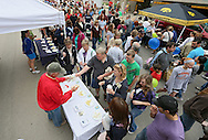 Don DeBruin (left), of Frisian Farms, makes a sale as people sample cheese at the Downtown Farmers' Market in Cedar Rapids on Saturday morning, June 2, 2012. There were 244 vendors who participated in the first market of the year. (Stephen Mally/Freelance)