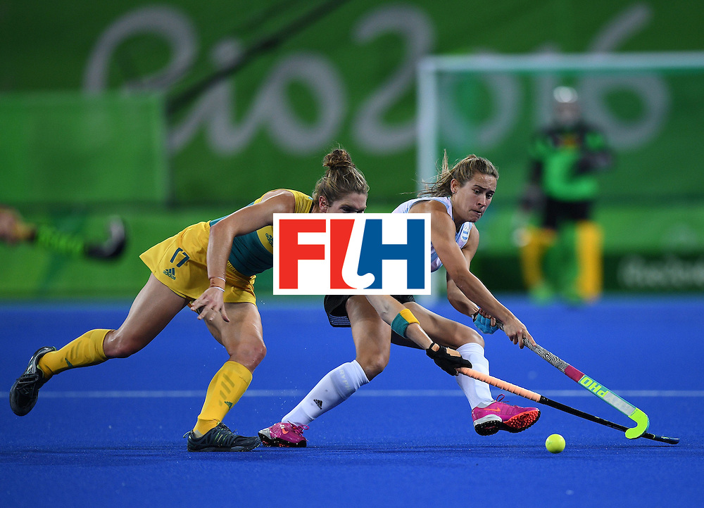 Australia's Georgina Morgan (L) vies for the ball with Argentina's Martina Cavallero during the women's field hockey Australia vs Argentina match of the Rio 2016 Olympics Games at the Olympic Hockey Centre in Rio de Janeiro on August, 11 2016. / AFP / MANAN VATSYAYANA        (Photo credit should read MANAN VATSYAYANA/AFP/Getty Images)
