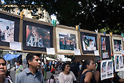 People look at photographs installed at the main Zocolo in Oaxaca. The photos document the 2006 Teachers strike.