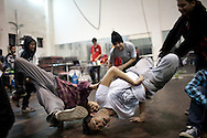A group of young people is practicing hip-hop in a training room. Hanoi, Vietnam, Asia