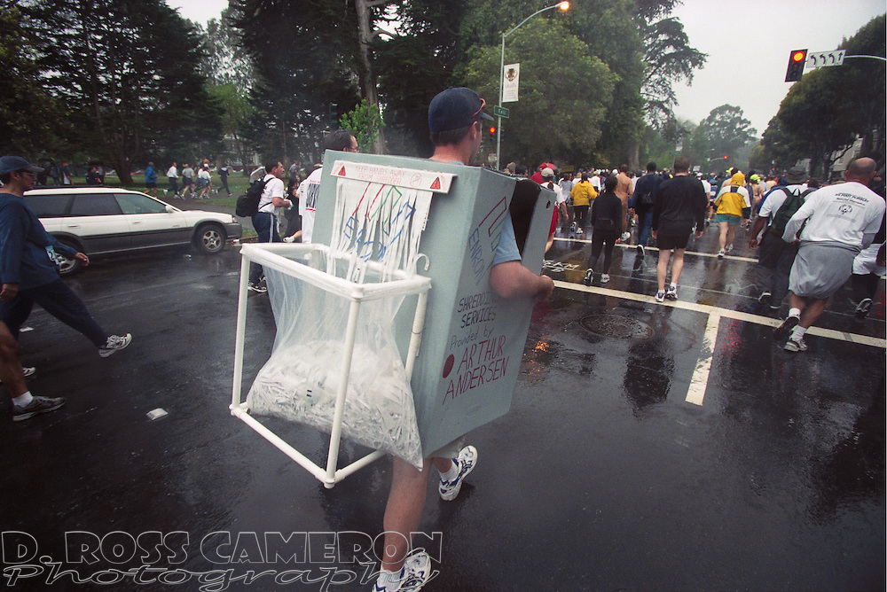 Peter Spellman of South Lake Tahoe captured the topical reference of the year with an Enron paper shredder costume for the 91st Bay to Breakers Sunday, May 19, 2002 in San Francisco.(Photo by D. Ross Cameron)