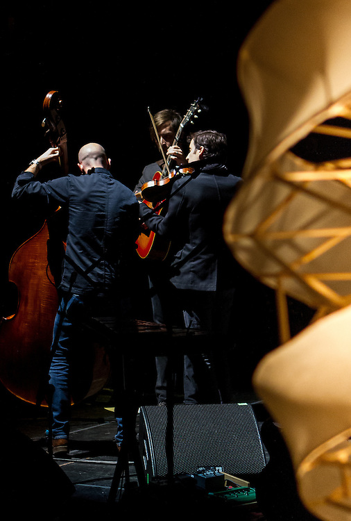 Andrew Bird and band performing at the Auditorium Theater, Chicago 2012.