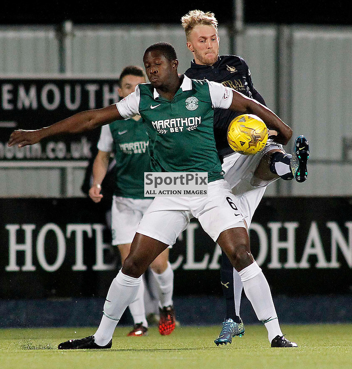 Hibernian's Marvin Bartley holds off Craig Sibbald<br /> in the Scottish Championship Match at the Falkirk Stadium(c) Andrew West | SportPix.org.uk