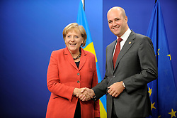 Angela Merkel, Germany's chancellor, left, is greeted by Fredrik Reinfeldt, Sweden's prime minister, as she arrives for the European Summit at the EU headquarters in Brussels, Belgium, on Thursday, Sept. 17, 2009. European Union leaders may call for sanctions on banks that pay excessive bonuses, fearing that runaway executive pay could trigger another financial crisis, a draft text showed. (Photo © Jock Fistick) *** Local Caption *** Angela Merkel.
