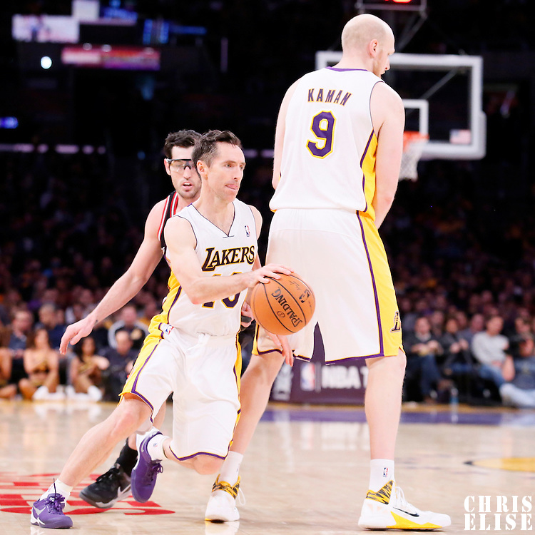 09 February 2014: Los Angeles Lakers point guard Steve Nash (10) drives past Chicago Bulls shooting guard Kirk Hinrich (12) on a screen set by Los Angeles Lakers center Chris Kaman (9) during the Chicago Bulls 92-86 victory over the Los Angeles Lakers at the Staples Center, Los Angeles, California, USA.