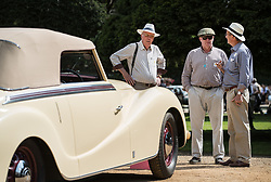 © Licensed to London News Pictures. 02/09/2017. London, UK. Visitors to the Concours of Elegance show admire a 1943 Alfa Romeo 6C 2500 Garavini Cabriolet on display in the grounds of Hampton Court Palace. The Concours of Elegance brings together, over three days, a selection of 60 of the rarest cars from around the world some of which have never been seen before in the UK. Each car owner is asked to vote on the other models on display to decide which car is considered to be the 'Best of Show'. The show also displays of hundreds of other fine motor cars, including entrants to The Club Trophy. Photo credit: Peter Macdiarmid/LNP