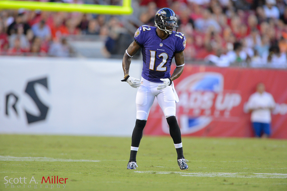 Baltimore Ravens wide receiver Jacoby Jones (12) during a preseason NFL game at Raymond James Stadium on Aug. 8, 2013 in Tampa, Florida. <br /> <br /> &copy;2013 Scott A. Miller