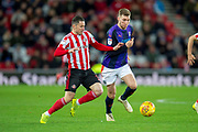 Bryan Oviedo (#3) of Sunderland AFC tackles Jack Stacey (#7) of Luton Town FC during the EFL Sky Bet League 1 match between Sunderland AFC and Luton Town at the Stadium Of Light, Sunderland, England on 12 January 2019.