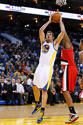 Jan 25, 2012; Oakland, CA, USA; Golden State Warriors power forward David Lee (10) shoots against the Portland Trail Blazers during the first quarter at Oracle Arena. Golden State defeated Portland 101-93. Mandatory Credit: Jason O. Watson-US PRESSWIRE