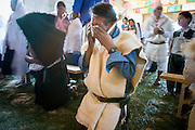 """25 APRIL 2005 - SAN CRISTOBAL DE LAS CASAS, CHIAPAS, MEXICO: A Mayan Indian man prays during a first communion mass in the Chamulan Indian community of Yaaltsunum near San Cristobal de las Casas. The Catholic Church in the Chiapas highlands is facing a threat from evangelical Protestant churches, which are experiencing explosive growth, and from """"traditionalist"""" Catholic churches, which are not affiliated with the San Cristobal diocese and are controlled by local politicians and powerful indigenous leaders affiliated with the politicians. The traditionalists burn down churches and chapels affiliated with the diocese, threaten the priests and put indigenous men who worship with the diocese in jail.  PHOTO BY JACK KURTZ"""