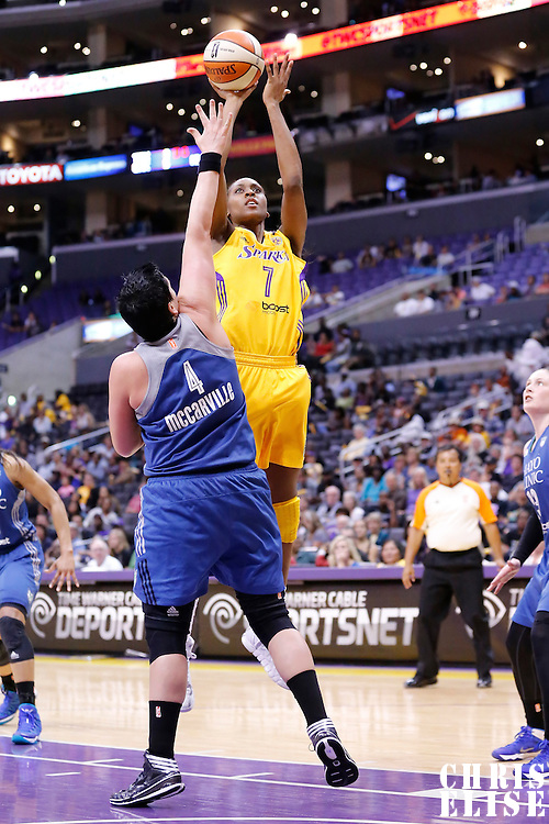 17 June 2014: Los Angeles Sparks forward/center Sandrine Gruda (7) takes a jumpshot over Minnesota Lynx center Janel McCarville (4) during the Minnesota Lynx  94-77 victory over the Los Angeles Sparks, at the Staples Center, Los Angeles, California, USA.