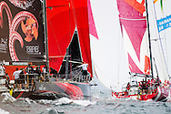 Puma, Camper & Sanya leaving the upwind mark under spinnaker at the in-port race during the 2011-2012 Volvo Ocean Race Miami stopover.
