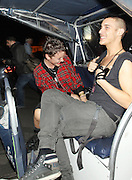 17.JULY.2012. LONDON<br /> <br /> JAIME WINSTONE LEAVING THE MADONNA MDNA GIG IN HYDE PARK WITH A FRIEND A LITTLE WORSE FOR WEAR ON A RICKSHAW BEFORE HEADING TO THE GROUCHO CLUB IN SOHO.<br /> <br /> BYLINE: EDBIMAGEARCHIVE.CO.UK<br /> <br /> *THIS IMAGE IS STRICTLY FOR UK NEWSPAPERS AND MAGAZINES ONLY*<br /> *FOR WORLD WIDE SALES AND WEB USE PLEASE CONTACT EDBIMAGEARCHIVE - 0208 954 5968*