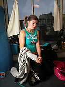 Emma wearing fashion sportswear, her hair in a pony-tail, at home, London, 2000's