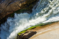 Water flowing rapidly through a gorge in the Orange River, Augrabies Falls National Park, Northern Cape, South Africa
