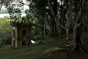 """The Wind Pump on the Southern slopes.<br /> <br /> LUNUGANGA the country home and & garden of Sri Lanka's most celebrated architect, Geoffrey Bawa...""""Lunuganga, Bentota, 1948-1997....The garden at Lunuganga sits astride two low hills on a promontory which juts out into a brackish lagoon lying off the estuary of the Bentota River.  In 1948, when Bawa first bought it, there was nothing here but an undistinguished bungalow surrounded by ten hectares of rubber plantation.  Since then hills have been moved, terraces have been cut, woods have been replanted and new vistas have been opened up, but the original bungalow still survives within its cocoon of added verandas, courtyards, and loggias."""" from geoffreybawa.com"""