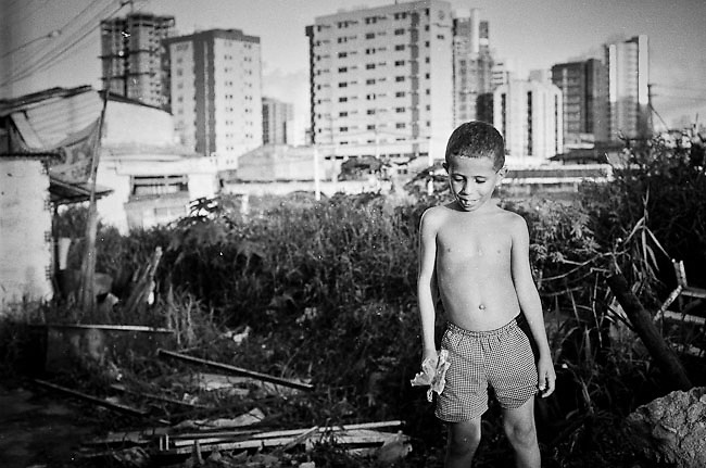 "Recife, Pernambuco, Brazil. Although the majority of Brazil's poor live in rural areas a jump in urban population growth has resulted in a concentration of poor families living in  shanty towns known as favelas. 80% of the population fo Brazil live today in urban areas. 45% of Brazil's children live in favelas where organized crime, drug use and child prostitution are part of the daily life. A greater part of the children that live in the favelas does not have acces to the education, thousands of children live on the street and they are exploited for sex tourism, or are victims of deadly squads that are pay it for ""cleaning"" the streets of them."