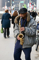 Guy with Saxophone playing for tips on Michigan Avenue, downtown Chicago