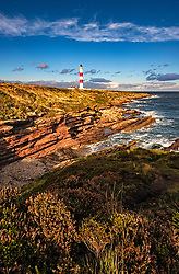 Tarbat Ness Lighthouse in the afternoon sun on the North Sea Coast, Scotland.