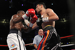 June 5, 2010; Bronx, NY; USA;  Joe Greene (white trunks) and Vanes Martirosyan (black trunks) trade punches during their bout at Yankee Stadium.  Martirosyan won via unanimous decision.