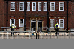 © Licensed to London News Pictures. 12/10/2018. WINDSOR, UK.  Police officers next to railings in Windsor ahead of the royal wedding of Princess Eugenie and Jack Brooksbank.  Princess Eugenie, 28, the younger daughter of the queen's third child Prince Andrew and his ex-wife Sarah Ferguson, the Duchess of York, will marry Jack Brooksbank, a 32-year-old drinks executive, in Windsor Castle before taking part in a short carriage procession through Windsor town.  This is the second royal wedding in Windsor in 2018, Prince Harry married Meghan Markle in May.  Photo credit: Stephen Chung/LNP