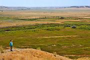 Boy overlooking prairie grasslands<br />Grasslands National Park<br />Saskatchewan<br />Canada