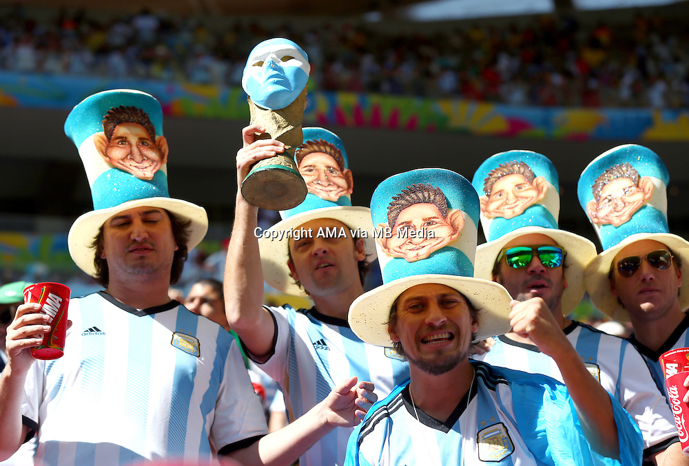 Fan of Argentina wearing Lionel Messi hats and carrying a replica world Cup trophy
