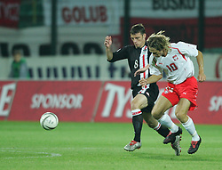 WARSAW, POLAND - WEDNESDAY, SEPTEMBER 7th, 2005: Wales' Jason Koumas and Poland's Miroslaw Szymkowiak during the World Cup Group Six Qualifying match at the Legia Stadium. (Pic by David Rawcliffe/Propaganda)