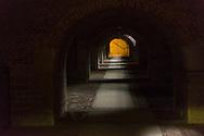 Belgie,  Hui, 20141008.<br /> In de bocht van de Maas ligt het stadje Huy in de Ardennen.  Het gangenstelsel in het Fort. Het Fort van Huy torent hoog boven de stad uit en kijkt uit op het water. Staat ook bekend als het Hollandse Fort. Dit fort werd in de zeventiende eeuw door de Nederlanders op de resten van het Kasteel van Hoei gebouwd.<br /> Huy is een Belgische stad en gemeente, gelegen aan de samenvloeiing van de rivieren de Maas, de Hoyoux en de Mehaigne. <br /> <br /> Belgium,  Huy, 20141008.<br /> In the bend of the river Meuse is the town of Huy in the Ardennes. Inside the Fort, tunnels. Huy Fort towering over the city and overlooks the water. Also known as the Dutch Fort. This fort was in the seventeenth century by the Dutch on the remains of Huy Castle built.<br /> Huy is a Belgian city and municipality, situated at the confluence of the rivers Meuse, Hoyoux and the Mehaigne.