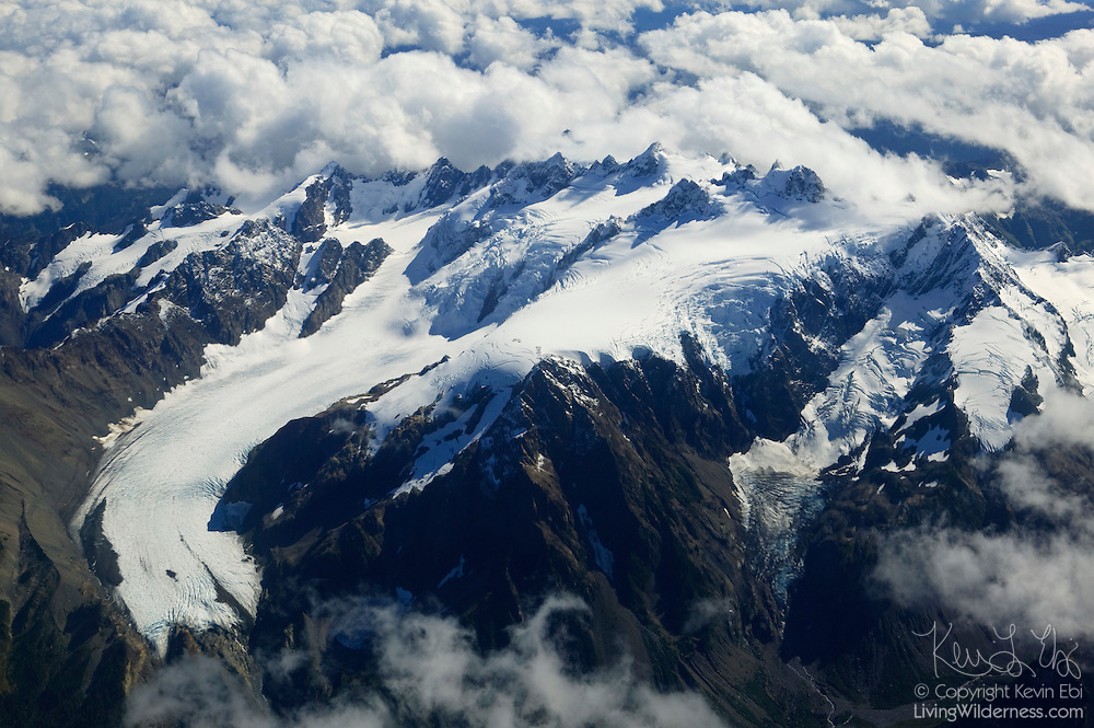 Mount Olympus, at just under 8000 feet, is the tallest of the Olympic mountains. This aerial view shows how the mountain range blocks rain storms from the Pacific Ocean, resulting in a temperate rain forest, the only one in North America.