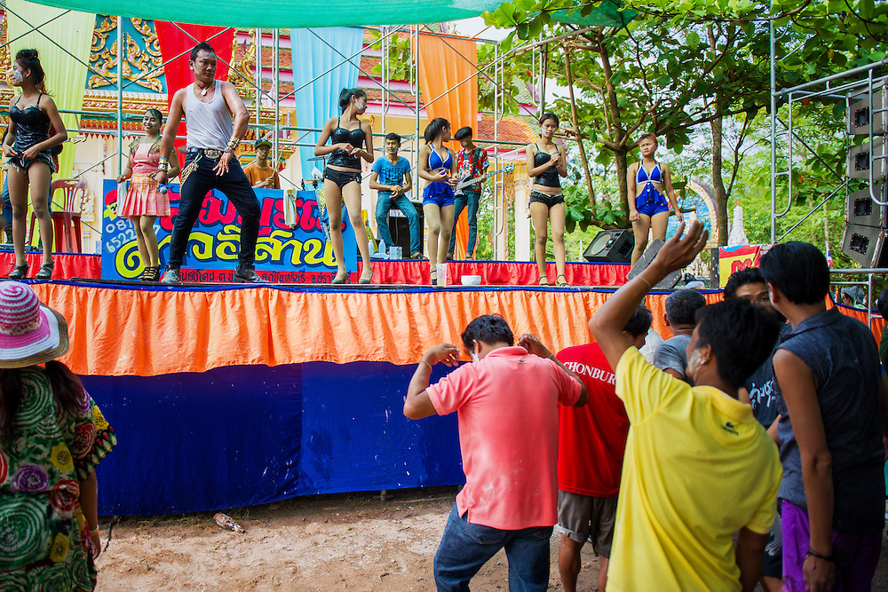 Local Thais enjoy live entertainment during a Songkran festival in rural Thailand April 13, 2015.