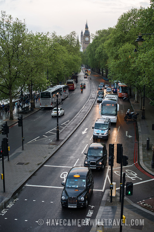 Evening traffic in London's Embankment area, with the clock tower of Big Ben (Elizabeth Tower) in the background.