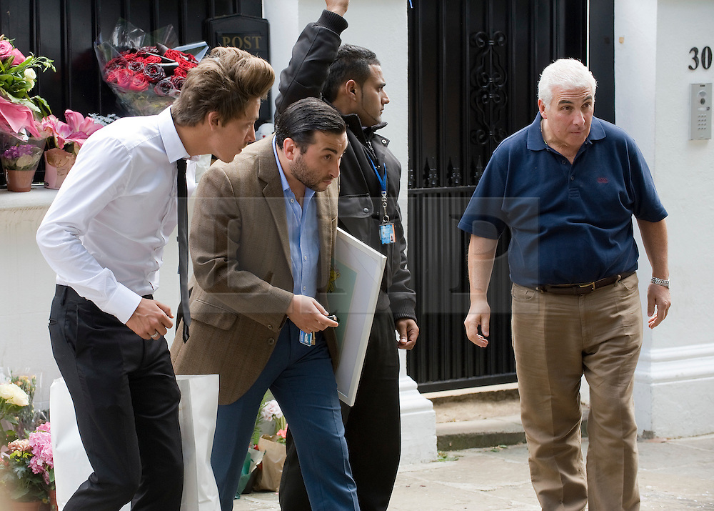 © licensed to London News Pictures.  28/07/2011. London, UK. Alex Winehouse (second left) Mitch Winehouse (right) leaving Amy's home in Camden, North London toady (28/07/2011) carrying personal items belonging to the singer. Photo credit: Ben Cawthra/LNP