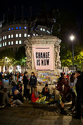 © Licensed to London News Pictures. 08/10/2019. London, UK. Extinction Rebellion set up camp in Trafalgar Square . Police continue to attempt to clear roads in Westminster on the second day of the protest . Photo credit: George Cracknell Wright/LNP