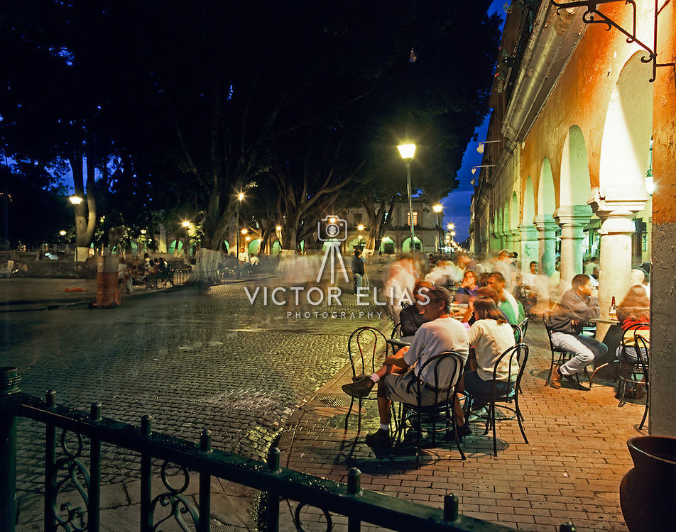 Colonial architecture in main plaza with tourist dining. Oaxaca, Mexico.
