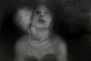 Double exposure of a young woman displaying fear Model released