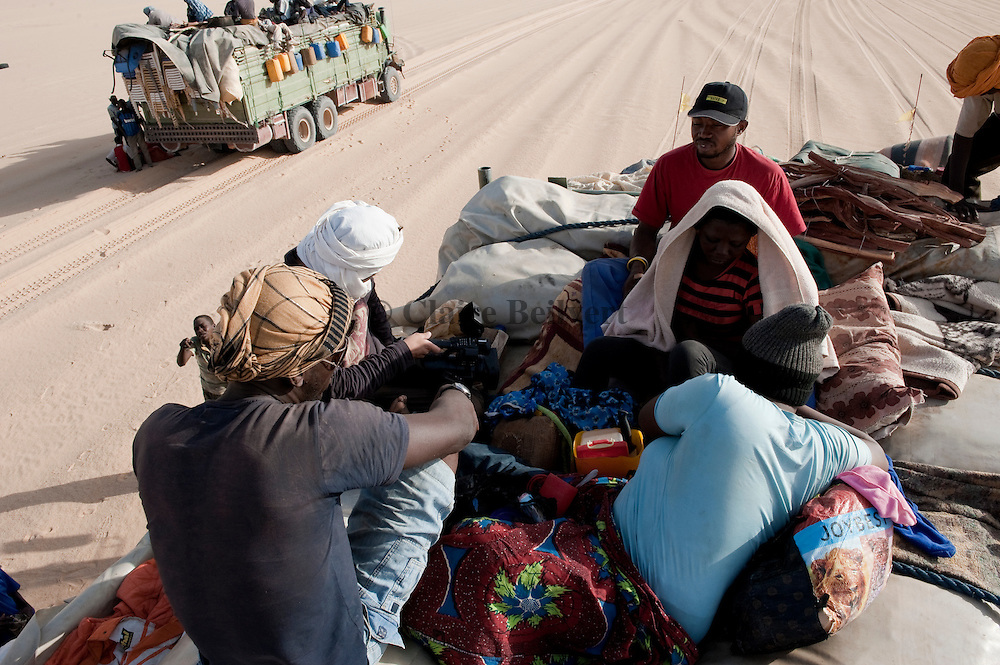 Samuel, a African migrant from Nigeria on a truck in the Ténéré desert. They are rapatrieted from Libya by IOM ( Internation Organization for Migration ) to Agadez, Niger.