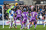 Bristol Rovers goalkeeper Steve Mildenhall punches clear during the Sky Bet League 2 match between Bristol Rovers and Plymouth Argyle at the Memorial Stadium, Bristol, England on 23 January 2016. Photo by Shane Healey.