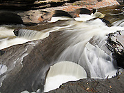 "The Presque Isle River carves round potholes in Nonesuch Shale rock before flowing into Lake Superior. Porcupine Mountains Wilderness State Park, Michigan, USA. Published in ""Light Travel: Photography on the Go"" by Tom Dempsey 2009, 2010."