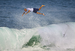December 11, 2017 - Banzai Pipeline, HI, USA - BANZAI PIPELINE, HI - DECEMBER 11, 2017 - Kelly Slater of the United States jumps out of a wave in the first round of the Billabong Pipe Masters. (Credit Image: © Erich Schlegel via ZUMA Wire)