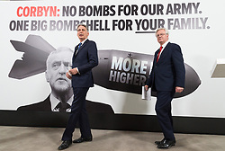 "© Licensed to London News Pictures. 03/05/2017. London, UK. Chancellor of the Exchequer PHILLIP HAMMOND and DAVID DAVIES the Secretary of State for Exiting the European Union speak at a General Election Campaign event featuring a poster of Labour party leader JEREMY CORBYN with the slogan ""More debt, higher tax."" Photo credit: Ray Tang/LNP"