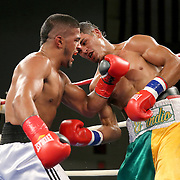 "Julio Santos (right) fights against Lazar Stojadinovic during a ""Boxeo Telemundo"" boxing match at the Kissimmee Civic Center on Friday, July 18, 2014 in Kissimmee, Florida.  (AP Photo/Alex Menendez)"